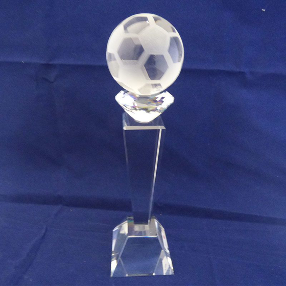 Picture of Glass football on a tall pedestal. 245mm